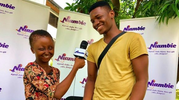 Miriam and Malick, young journalists with disabilities who were employed by the Niambie radio show.