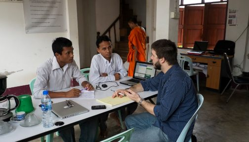 Three male human rights defenders have a meeting in Thailand.