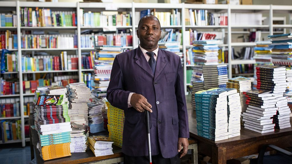 A man standing in a library.