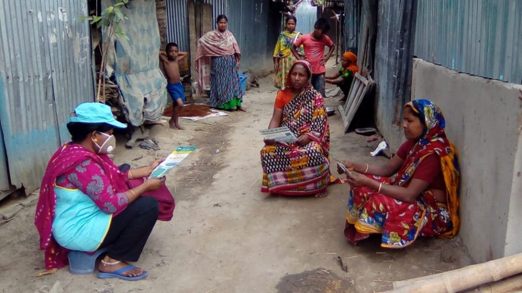 Information being disseminated to a community in Bangladesh.
