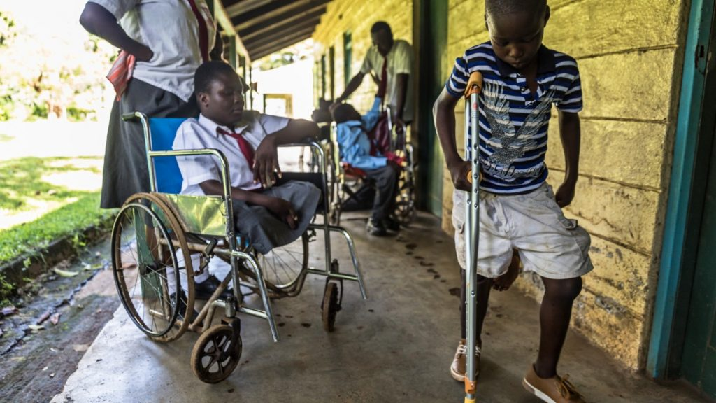 Anthony from Kenya, is seen here with a new bespoke crutch. and prosthetic leg.