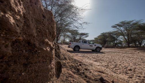 A car on sandy landscape.